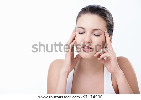 Young attractive girl suffers a headache - stock photo