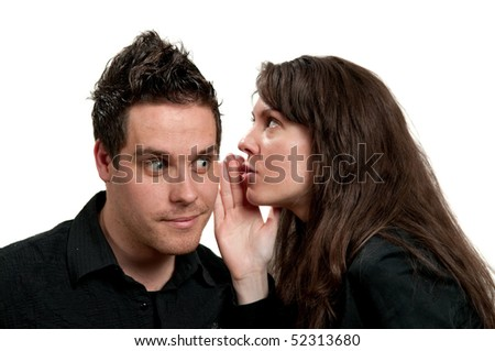 Young attractive girl whispering to a young man - stock photo