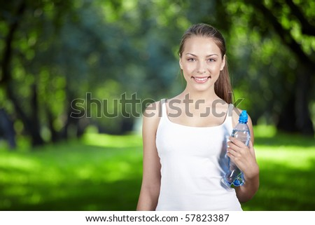 Young attractive girl with a bottle of water - stock photo