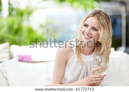 Young attractive girl with a glass at a restaurant - stock photo