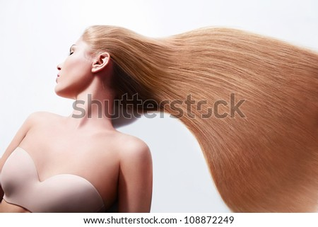 Young attractive girl with beautiful hair - stock photo
