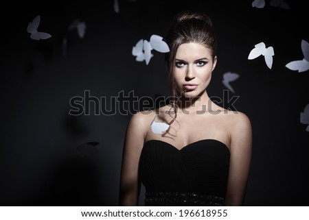 Young attractive girl with butterflies - stock photo