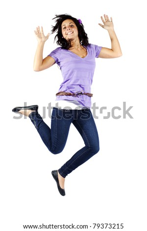 Young attractive girl with flower in her hair jumping against isolated background - stock photo