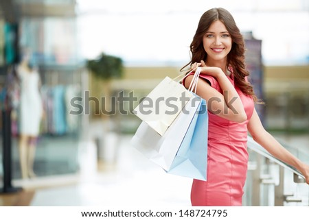 Young attractive girl with shopping bags