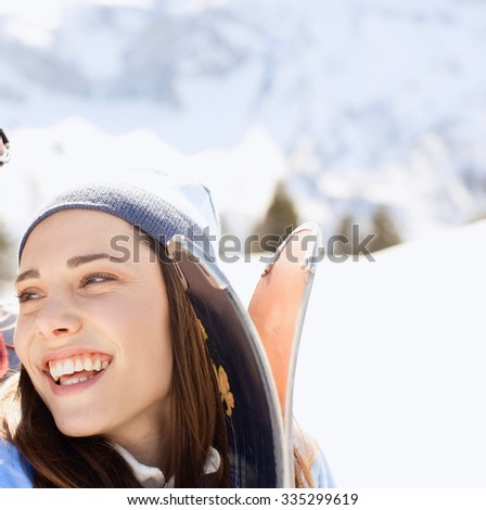 Young attractive girl with ski in winter  - stock photo
