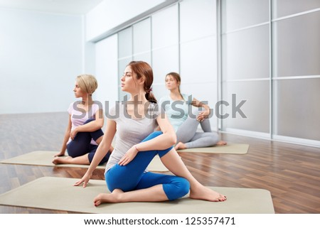 Young attractive girls do yoga
