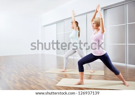 Young attractive girls do yoga - stock photo