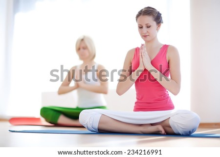 Young attractive girls do yoga. Seriya - stock photo
