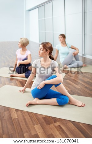 Young attractive girls doing stretching