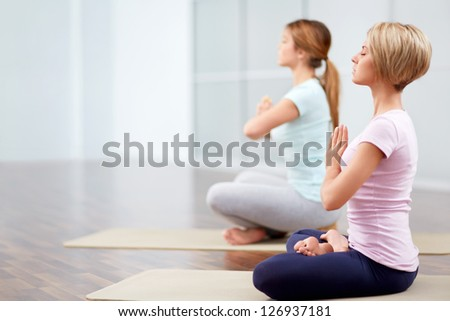 Young attractive girls in the lotus position