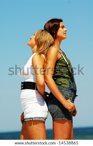Young attractive girls looking up to the sky
