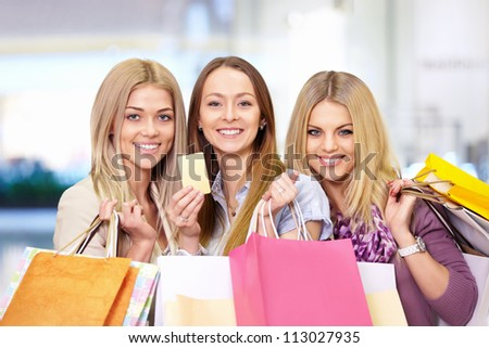 Young attractive girls with shopping bags and credit card - stock photo