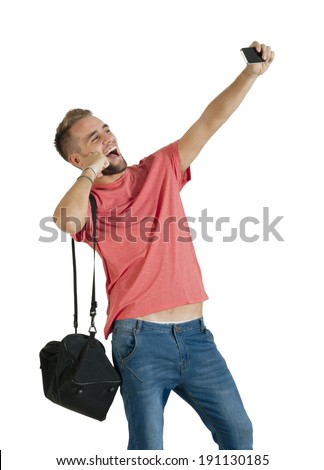 Young attractive guy taking selfie using mobile phone - stock photo