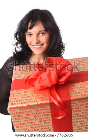 Young attractive hairdressed woman with big golden giftbox decorated with red bow in her hands - stock photo