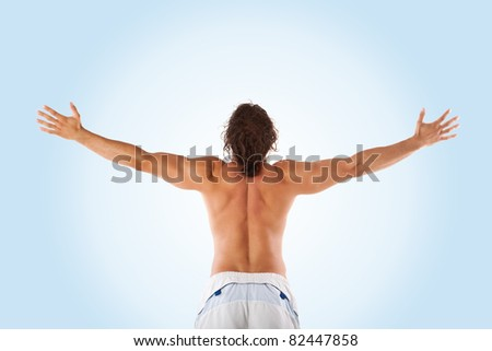 Young attractive half naked male with hands up, showing his perfect body from the back.happiness and peace concept - stock photo