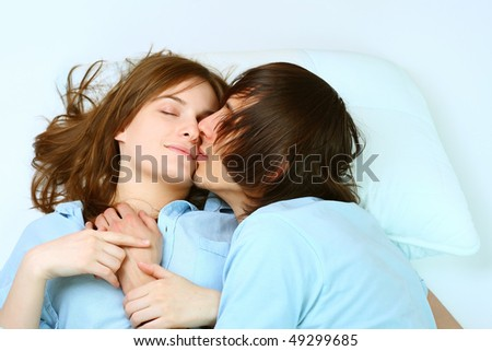 Young attractive happy amorous couple at bedroom - stock photo