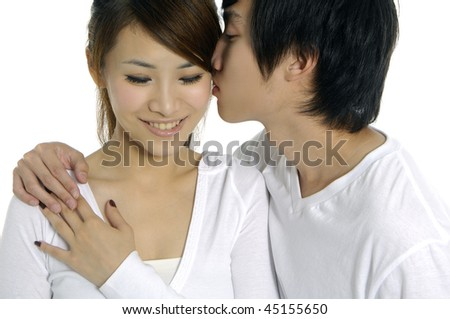 young attractive happy couple hand holding a green leaf - stock photo