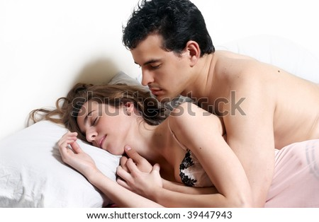 Young attractive happy couple  in bedroom - stock photo