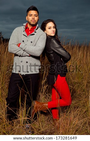 Young attractive happy couple in love posing outdoor.