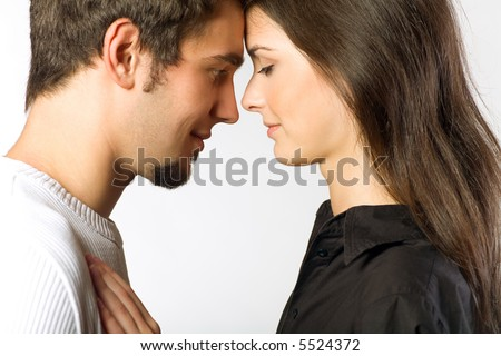 Young attractive happy smiling amorous couple embracing
