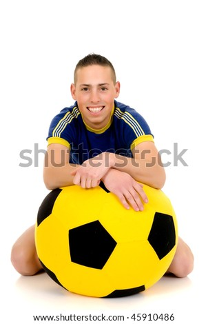 Young attractive happy soccer player with football on white background, studio shot - stock photo