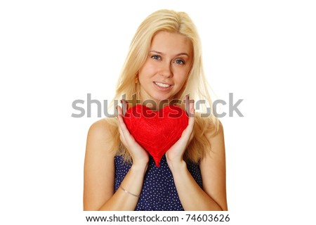 Young attractive happy woman holding big red heart. Isolated on a white background