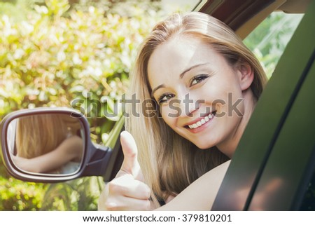 young attractive happy woman sitting in car summer portrait outdoor - stock photo