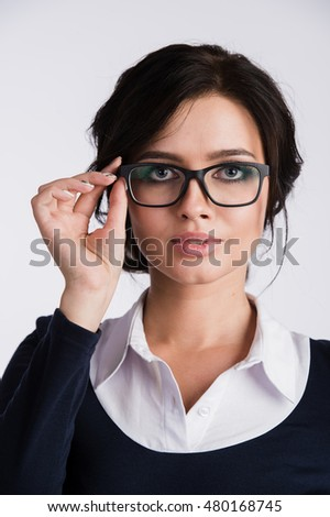 Young attractive happy woman trying on new glasses