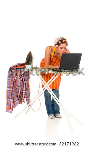 Young attractive housewife with curlers in hair doing household while surfing on internet with laptop, Studio, white background. - stock photo