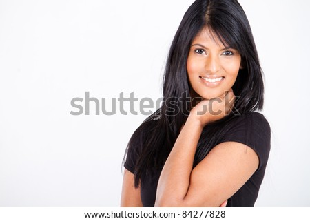 young attractive indian woman on white with copy space - stock photo