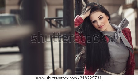 Young attractive latin woman posing, fashion photo - vogue style. Outdoor, outside - stock photo