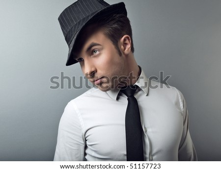 Young attractive macho in black hat