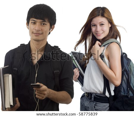 Young attractive male and female Asian students holding school books - stock photo