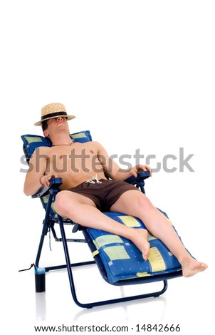 Young attractive male body builder relaxing in beach chair. Studio shot, white background.