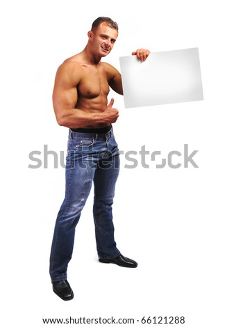 Young attractive male body builder with advertising copy space board. Studio shot, white isolated background.