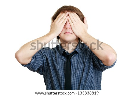 young attractive male cover eyes with his hands - stock photo
