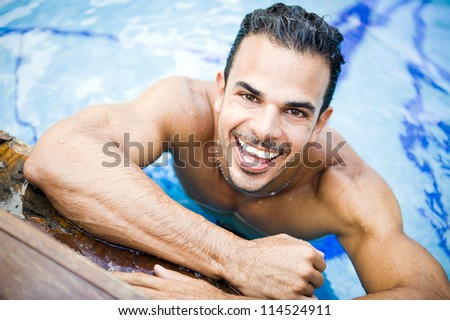 Young attractive man at the swimming pool - stock photo