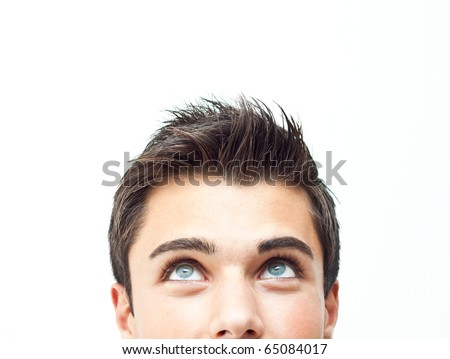 Young attractive man face looking up - stock photo