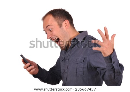 Young attractive man get very bad news on the phone and get very angry. White background. - stock photo