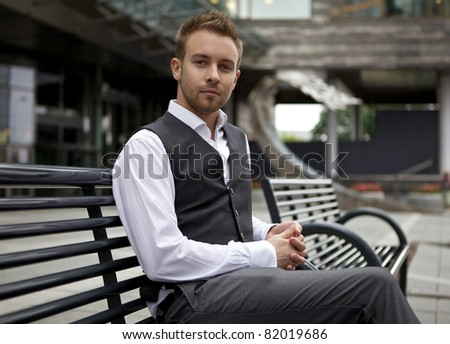 Young attractive man in urban background