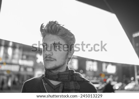 Young attractive man on the night city street - stock photo