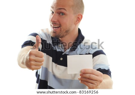 Young attractive man shows his great business card - white empty copy space, studio shoot isolated on white - stock photo