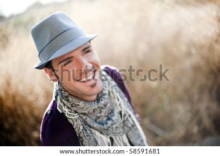 Young attractive man wearing a hat - stock photo
