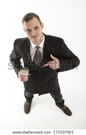 young attractive man with drink glass on white