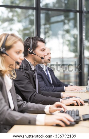 Young attractive man working in a call center - stock photo
