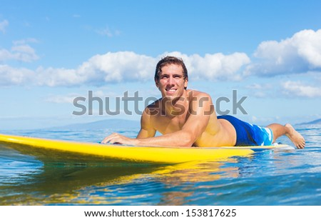 Young Attractive Mann on Stand Up Paddle Board, SUP, in the Blue Waters off Hawaii - stock photo