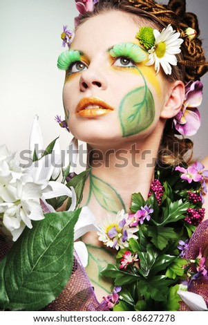 Young attractive model posing as Spring Lady. - stock photo
