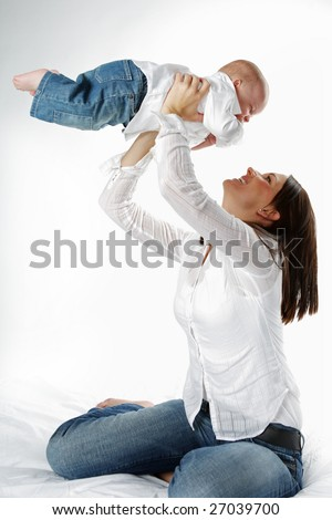 Young attractive mother with cute child. - stock photo