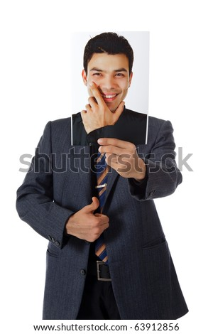 Young attractive nepalese businessman holding its own photo in one hand and a thumb-up. Point of conscience. Studio shot. White background.