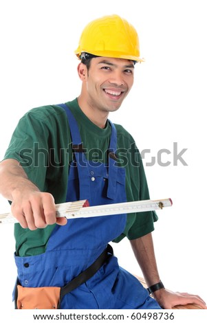 Young attractive Nepalese carpenter measuring working happy. Studio shot. White background. - stock photo